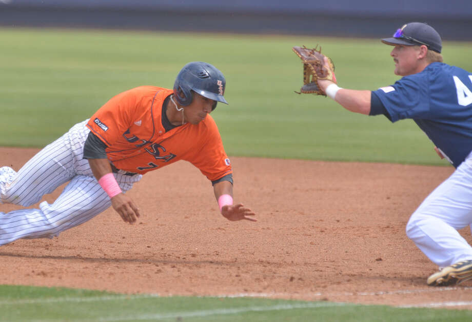 UTSA's Tony Ramirez dives back to first base as Rice's Skyler Ewing takes the throw from the pitcher on a pick-off play in the second inning. Ramirez was called out by the umpire. Photo: Robin Jerstad / San Antonio Express-News