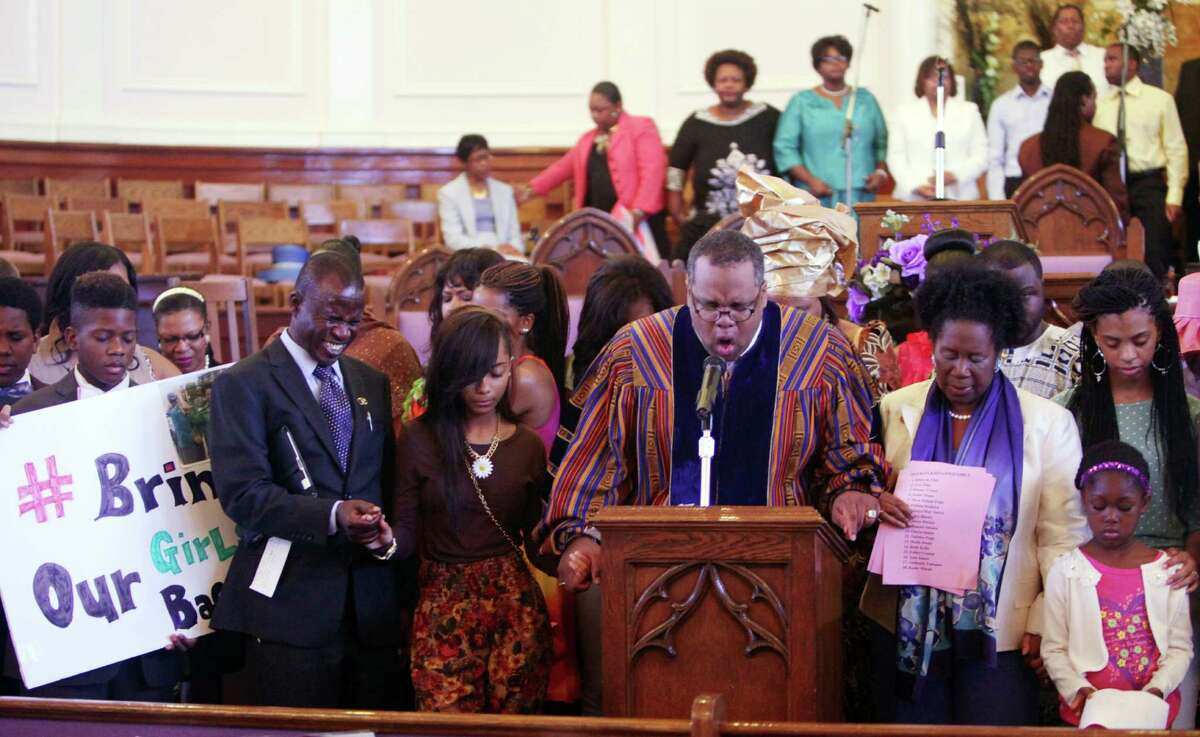 Terrence Grant Malone, a senior pastor, led the congregation in prayer Sunday during the Mother's Day Prayer Vigil at St. John Missionary Baptist Church.