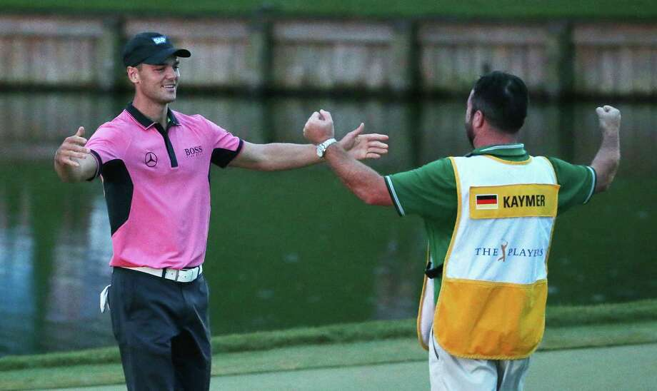 PONTE VEDRA BEACH, FL - MAY 11:  Martin Kaymer of Germany celebrates on the 18th green with his caddie Craig Connelly after his one-stroke victory at THE PLAYERS Championship on The Stadium Course at TPC Sawgrass on May 11, 2014 in Ponte Vedra Beach, Florida.  (Photo by Richard Heathcote/Getty Images) ORG XMIT: 461733349 Photo: Richard Heathcote / 2014 Getty Images