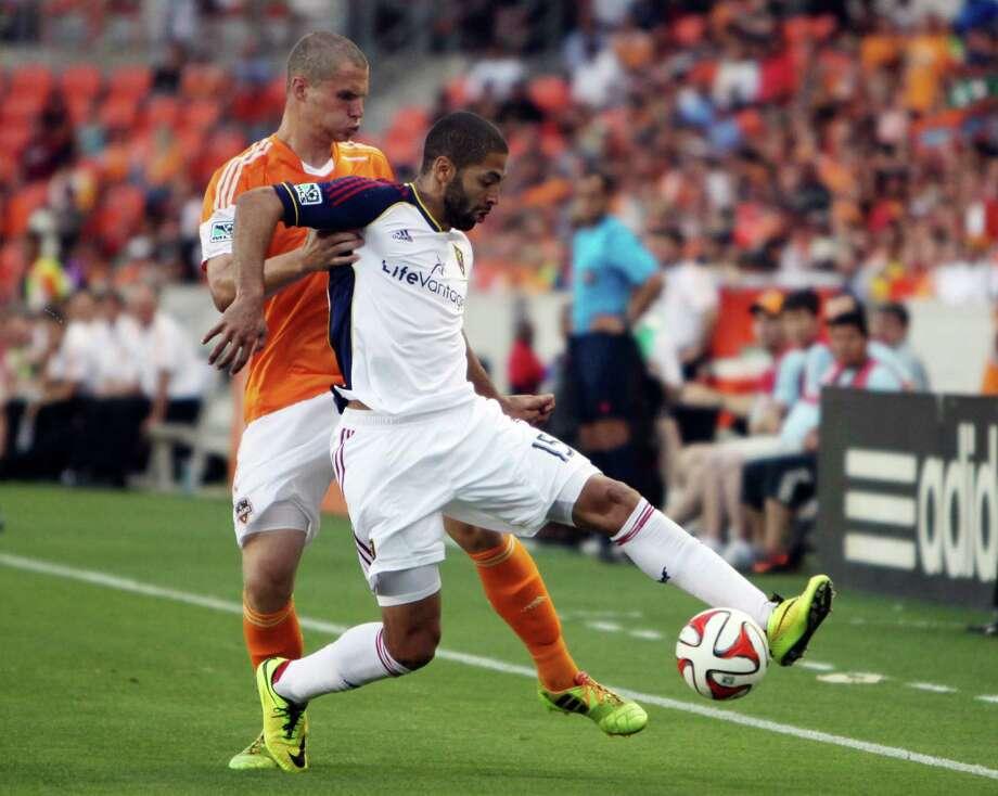 Houston Dynamo's (#16) A.J. Cochran covers Real Salt Lake (#15) Alvaro Saborio who scored a goal in the first half at BBVA Compass Stadium on May 11, 2014, in Houston Tx.  Real Salt Lake wins 5-2 over the Houston Dynamo. Photo: Mayra Beltran, Houston Chronicle / © 2014 Houston Chronicle