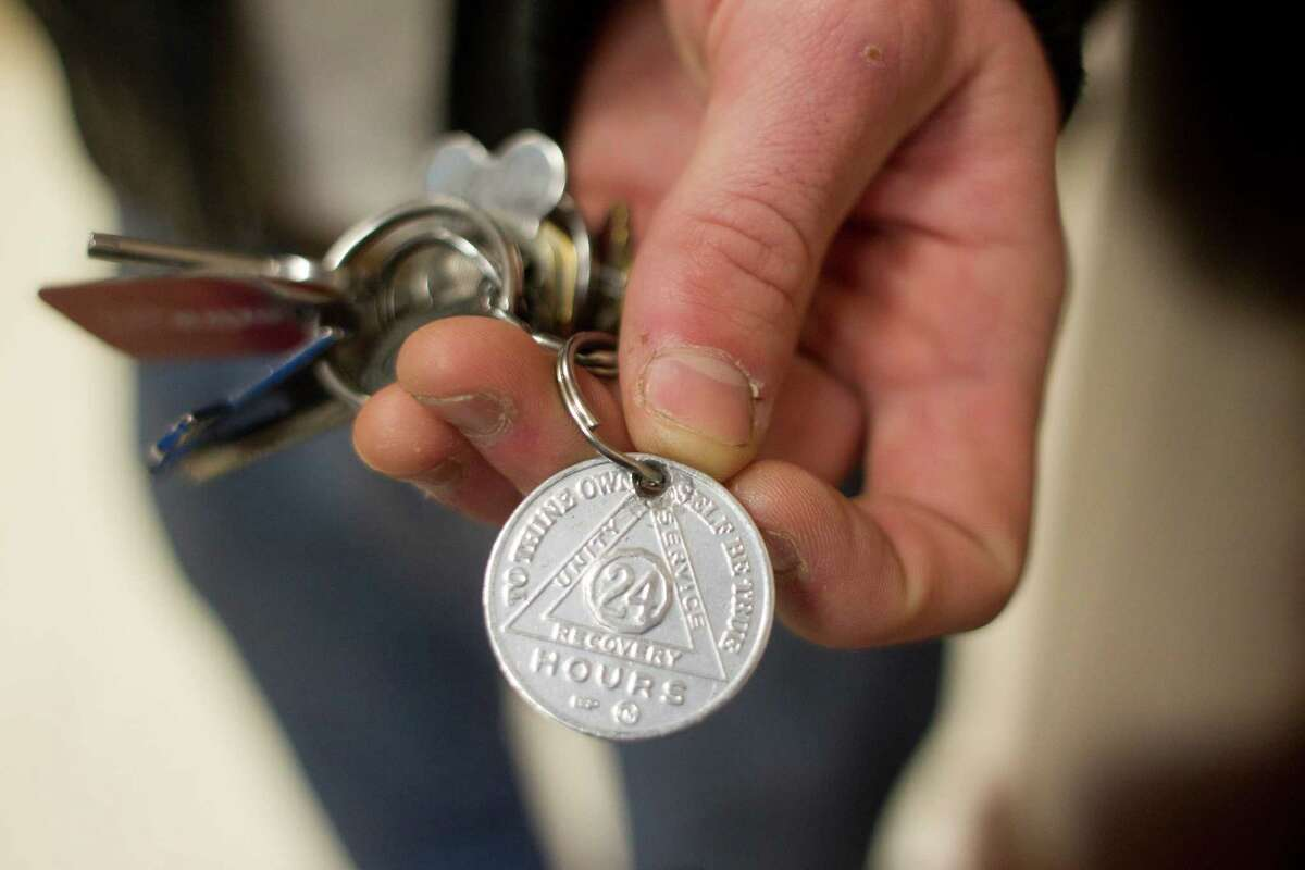"""Stapp holds his first Alcoholics Anonymous 24 hour sober coin. """"I was an out of control mess,"""" he said."""