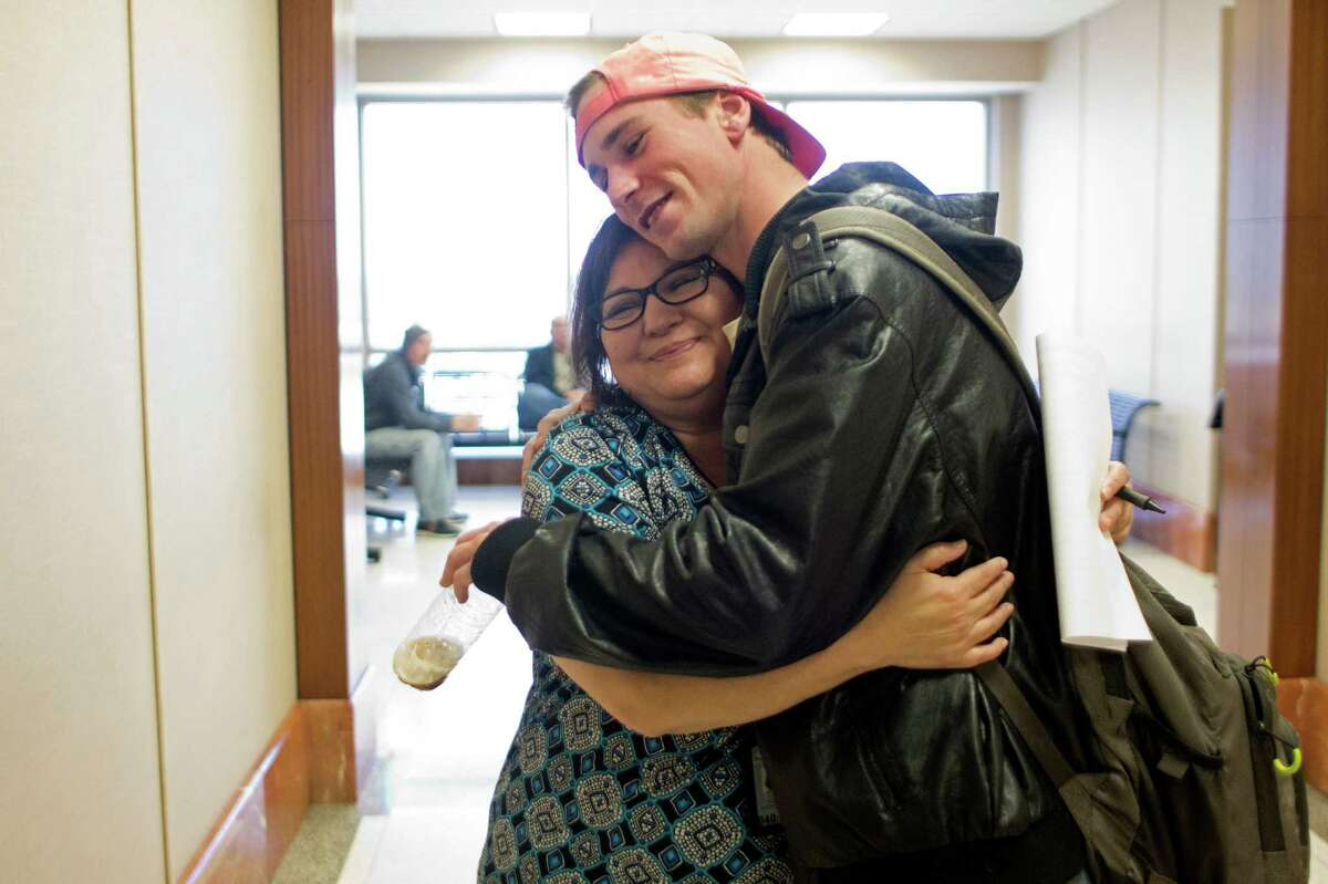 Ryan Stapp, 22, gets a hug from Sober Court Coordinator Rachael Ferrel, at the Harris County Criminal Justice Center. Stapp is a recent graduate of the county's Saving Ourselves By Education & Recovery (S.O.B.E.R.) DWI program.
