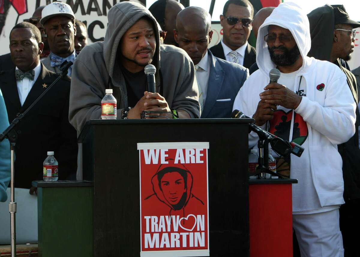 Robbie Tolan, left, speaks during a rally for Trayvon Martin on March 26, 2012. Tolan hired Martin's family's lawyer, Benjamin Crump, after the Supreme Court reinstated his case.