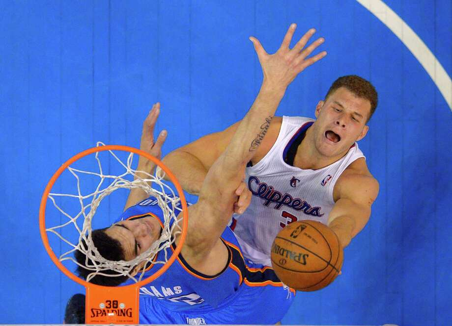 Los Angeles Clippers forward Blake Griffin, right, shoots as Oklahoma City Thunder center Steven Adams, of New Zealand, defends in the second half of Game 4 of the Western Conference semifinal NBA basketball playoff series on Sunday, May 11, 2014, in Los Angeles. The Clippers won 101-99. (AP Photo/Mark J. Terrill)  ORG XMIT: LAS137 Photo: Mark J. Terrill / AP