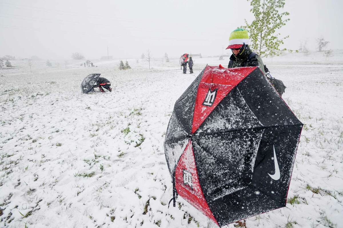Keith Vest competes in a disc golf tournament Sunday, May 11, 2014, at Aggie Greens in Fort Collins, Colorado. Snow is expected to fall through Monday, with highs reaching the sixties later this week. (AP Photo/The Coloradoan, Erin Hull)
