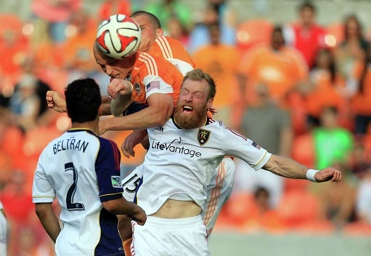 Aggressive play like this enabled Dynamo rookie forward Mark Sherrod, center, to score his first two MLS goals Sunday.
