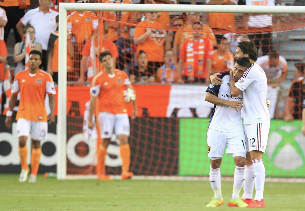 Real Salt Lake midfielder Javier Morales, left, celebrates one of his three goals Sunday. Morales was busy the entire match, scoring his first goal in the opening minute and his last on a penalty kick in the 89th.