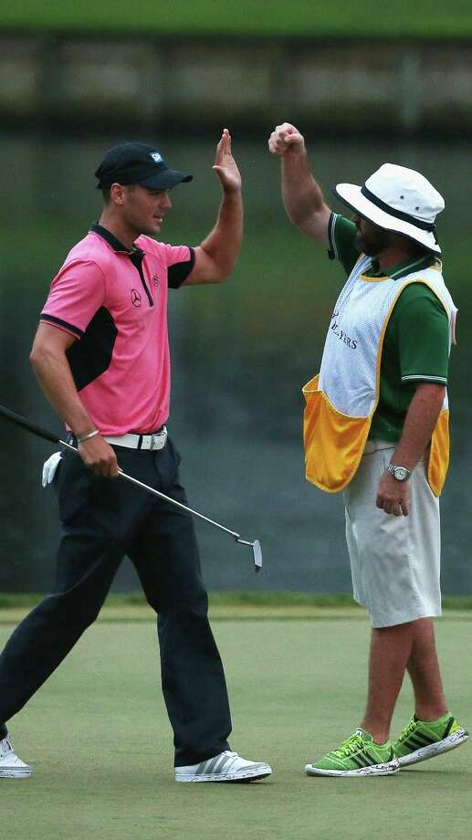 Martin Kaymer (left) celebrates with caddie Craig Connelly after making a long par putt on No. 17 to win The Players Championship. Photo: Richard Heathcote / Getty Images / 2014 Getty Images