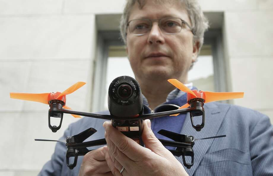 In this May 8, 2014 photo, Parrot CEO Henri Seydoux holds a Parrot Bebop drone at a Parrot event in San Francisco. The Parrot Bebop drone, which has a 14-megapixel fish-eye camera lens and battery life of about 12 minutes flying time, is scheduled to be released later this year. (AP Photo/Jeff Chiu) Photo: Jeff Chiu, Associated Press