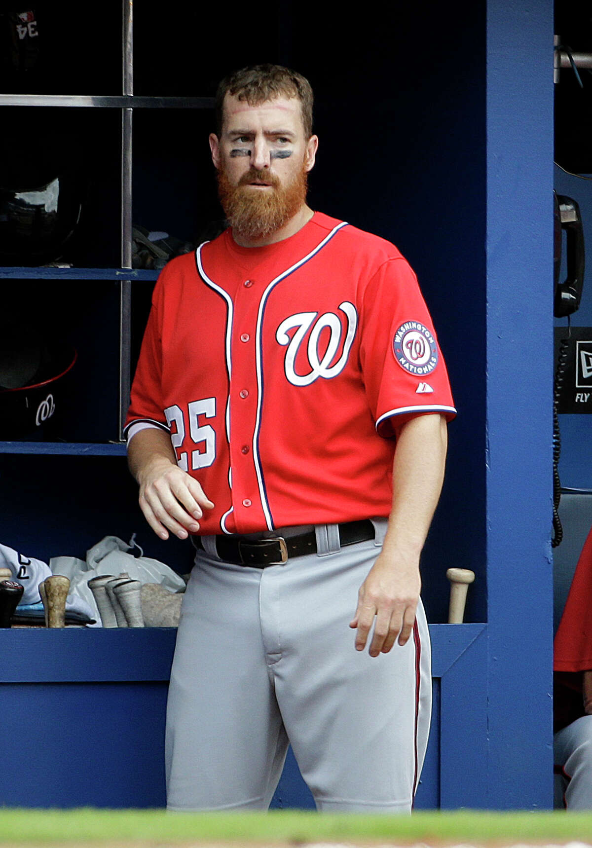 Washington Nationals' Adam LaRoche looks out from the dugout after hitting a home run in the ninth inning of a baseball game against the Atlanta Braves, Sunday, April 13, 2014, in Atlanta. The Braves won 10-2. (AP Photo/David Goldman)