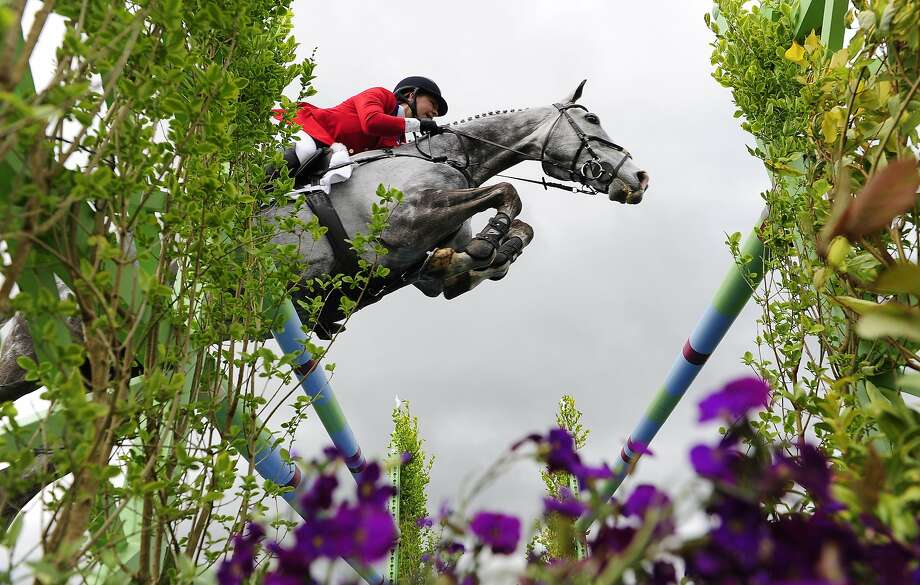 BADMINTON, ENGLAND - MAY 11:  Tiana Coudray of The USA riding Ringwood Magister during the Show Jumping on day five of the Badminton Horse Trials on May 11, 2014 in Badminton, England.  (Photo by Dan Mullan/Getty Images) *** BESTPIX *** Photo: Dan Mullan, Getty Images