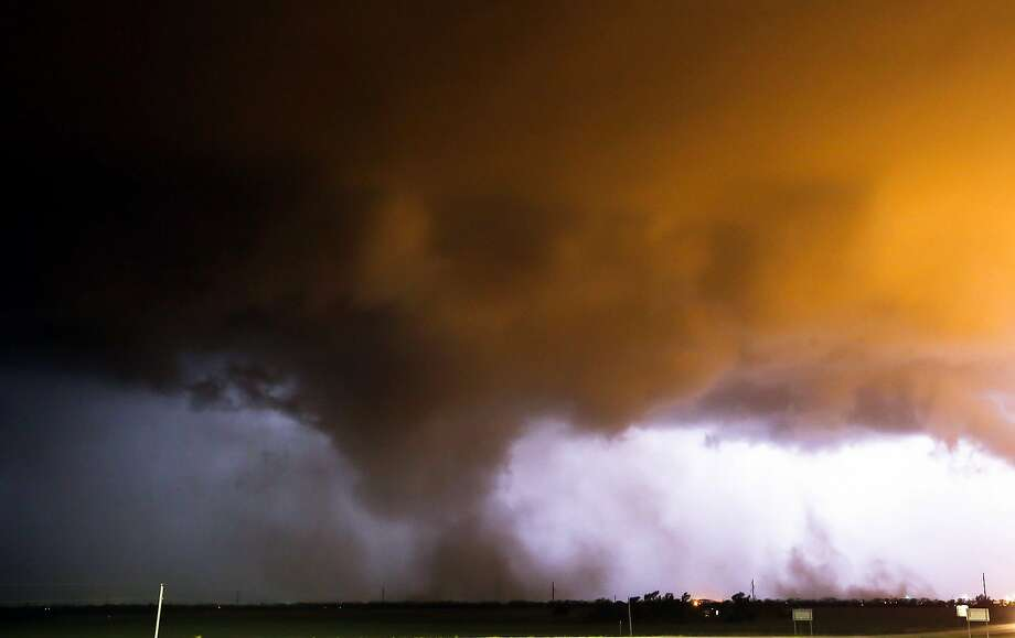 Storm clouds can be seen forming just south of McPherson, Kan., on Sunday, May 11, 2014. Storms could produce large hail, damaging winds and a few tornadoes, particularly across central Kansas. (AP Photo/The Wichita Eagle, Travis Heying) Photo: Travis Heying, Associated Press
