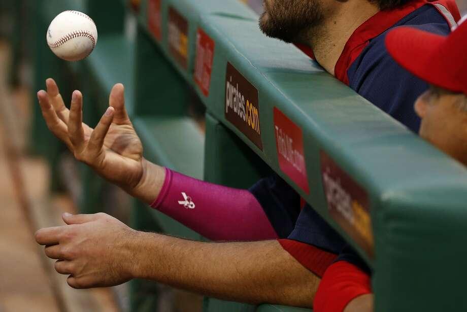 St. Louis Cardinals starting pitcher Lance Lynn tosses a ball as he stands in the dugout before a baseball game against the Pittsburgh Pirates in Pittsburgh Sunday, May 11, 2014. The Cardinals won 6-5. (AP Photo/Gene Puskar) Photo: Gene Puskar, Associated Press