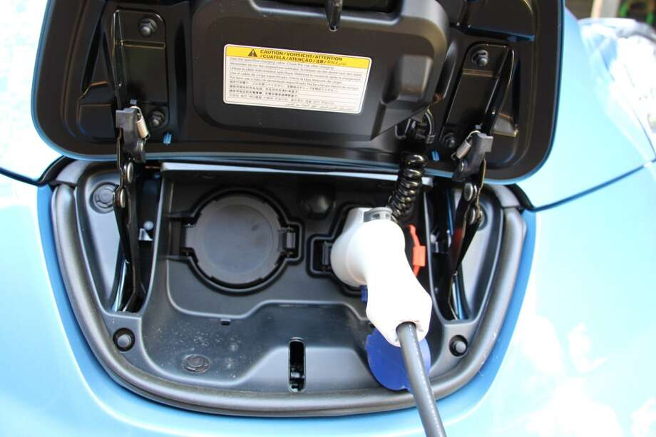 The 120-volt charging cord is plugged in. Charging at 120 volts can take up to 21 hours.