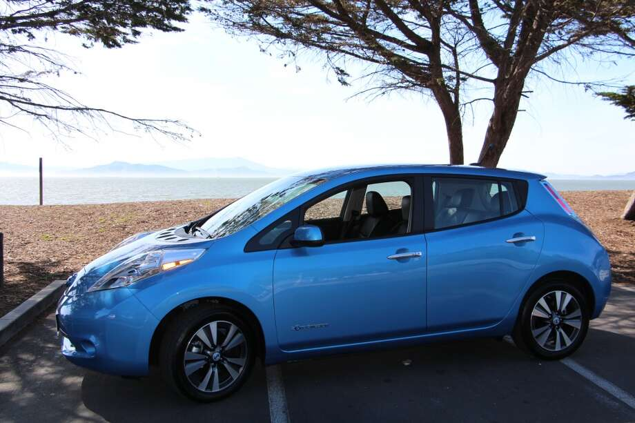 The 2014 Nissan Leaf is a pretty interesting car. It's very quiet, powered, as it is, by a little 107-horsepower electric motor up front, a motor about the size of a football. It's doing all the work, powering all the electronic aids we take for granted – heating and air conditioning, navigation, audio, and a wild array of tell-all lights and chimes.  (All photos by Michael Taylor.)