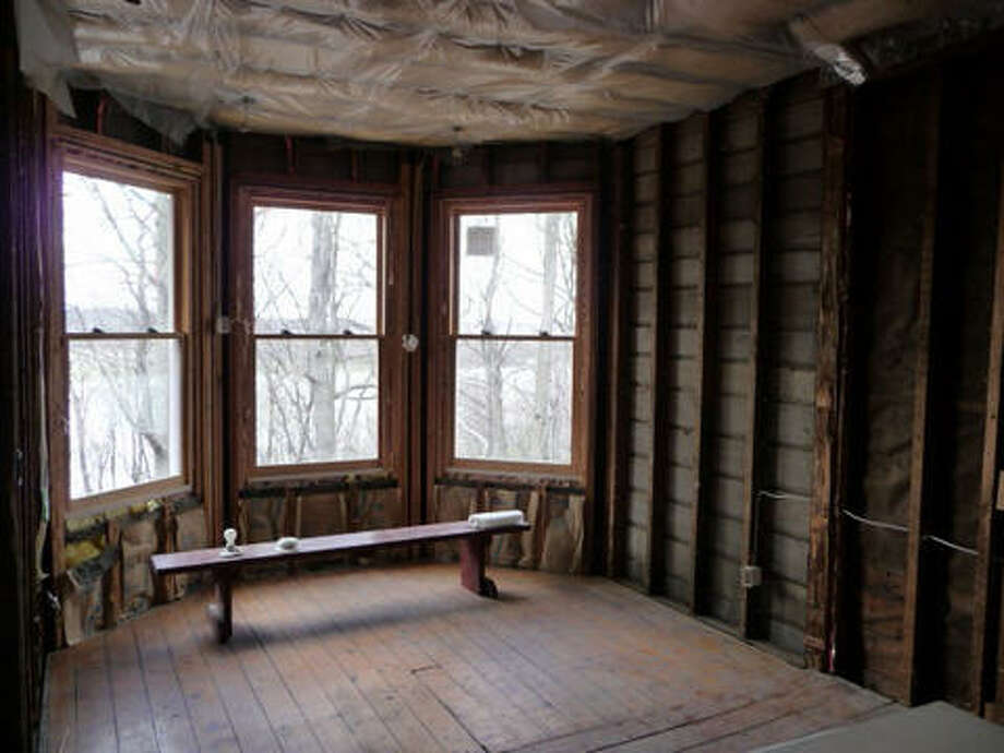 Before: The new windows are installed, old insulation and sheetrock removed. Read more about this project. Photo: Picasa 2.7, Joe Keegan