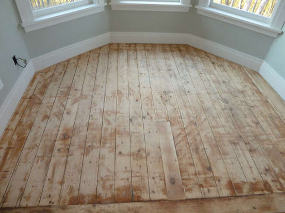 Before: Floor of the master bedroom after sanding with an orbital sander. In retrospect, hand sanding may have yielded better results. Read more about the project.   Photo: Picasa, Joe Keegan