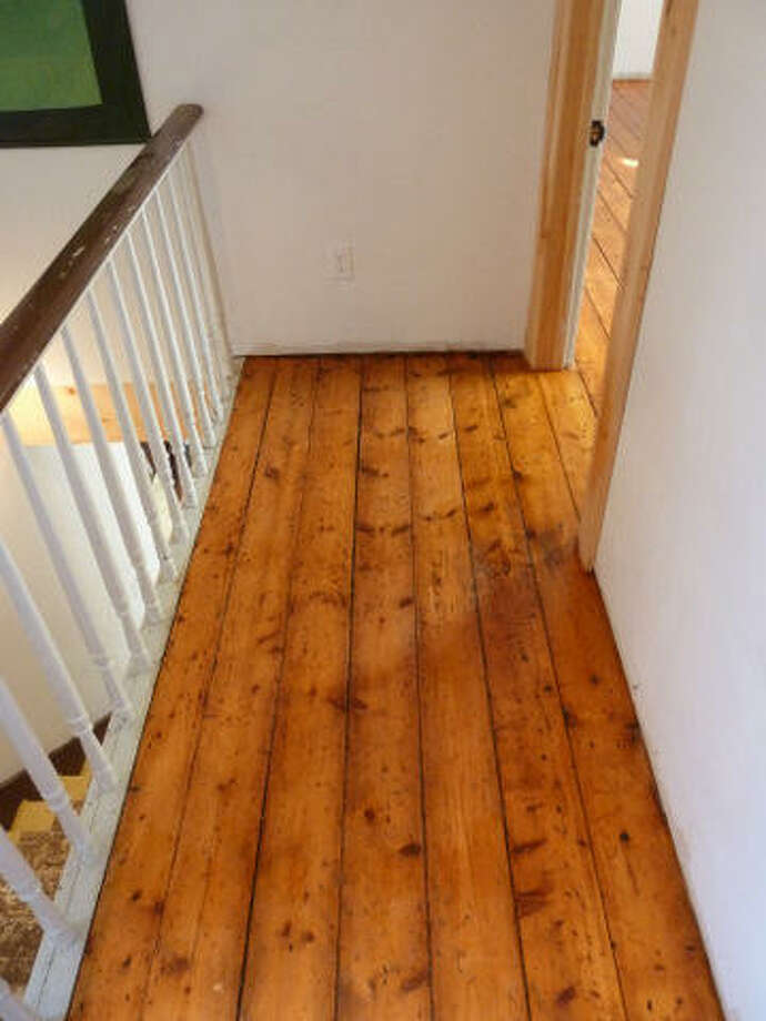 After: Refinished floor in the upstairs hallway. Read more about the project. Photo: Joe Keegan