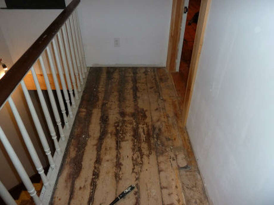 Before: The floor in the hallway also needed to be refinished.Read more about the project. Photo: Picasa, Joe Keegan
