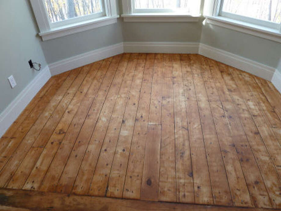 Before: Floor of the master bedroom, hand-scraped and ready for refinishing. Read more about the project. Photo: Joe Keegan