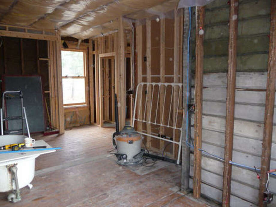 Before: The master bathroom before sheetrock or insulation. Read more about this project. Photo: Picasa 2.7, Joe Keegan