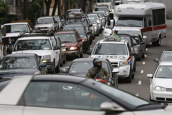 Traffic on Oak Street getting onto Octavia Boulevard as traffic line up to enter the freeway in San Francisco, Calif.,  on Monday, July 2, 2012.