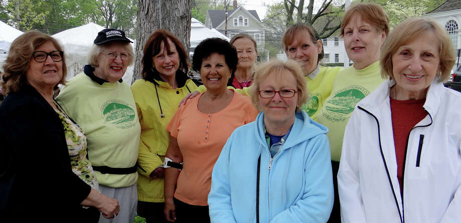 Fairfield Woman's Club members, from left, Lois Holly, Lois Smith, Betty Walsh, Corinne Dellaera, Barbara Gomperts, Ann Lamson, Lisa Winkel, Carol Dawid and Edia Szabo at the club's 32nd annual Crafts Fair on Town Hall Green Saturday. Photo: Mike Lauterborn / Fairfield Citizen