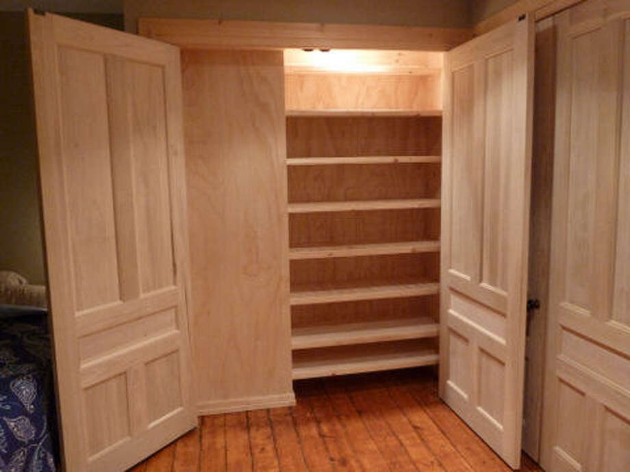 After: New closet with plenty of shelves. Read more about this project. Photo: Picasa, Joe Keegan