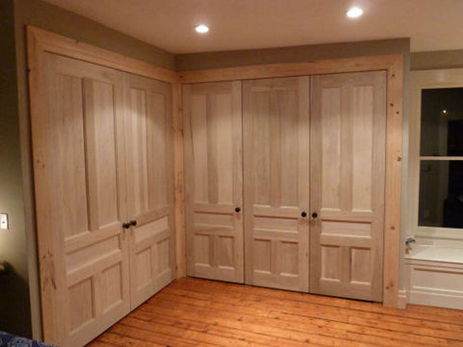 After: Notice the absence of hinges on all the doors. Pivot hinges which mount into the floor were used instead to gives the doors a nice, clean look. Read more about this project. Photo: Picasa, Joe Keegan