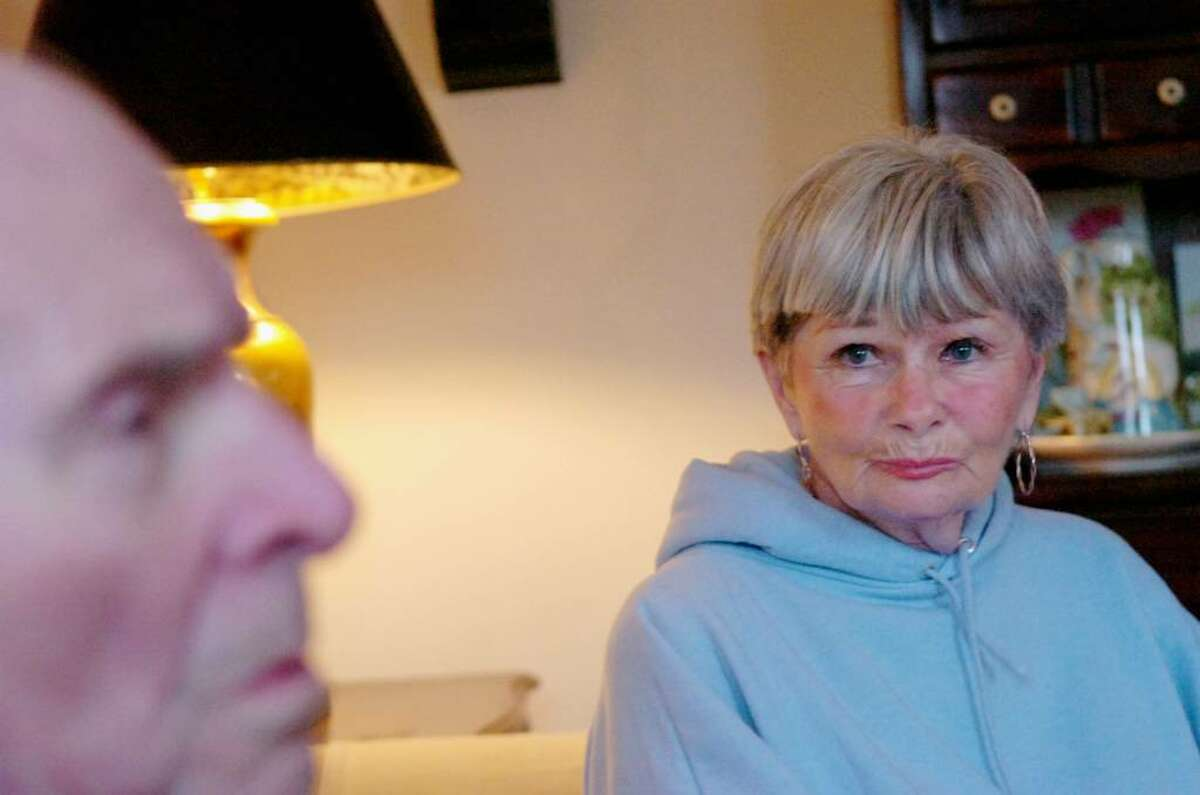B.J. Hocter eyes her husband, Don, in their Cos Cob home Tuesday afternoon, February 9, 2010. Don Hocter, 82, is in the late stage of Alzheimer's disease which leaves him completely dependent on his wife.