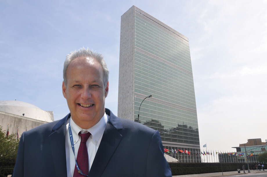 Ken Champion, of New Fairfield, has been overseeing a $2.1 billion renovation of the United Nations in Manhattan, N.Y. His teams have been involved in everything from redesigning workspaces and updating security systems to preserving priceless artworks. He's seen here in front of the Secretariat, the U.N. headquartersí landmark building, which took nearly five years to restore. Now modern and eco-friendly, the 39-story glass façade and building houses the offices of U.N. staff and delegates. Photo: Contributed Photo / The News-Times Contributed