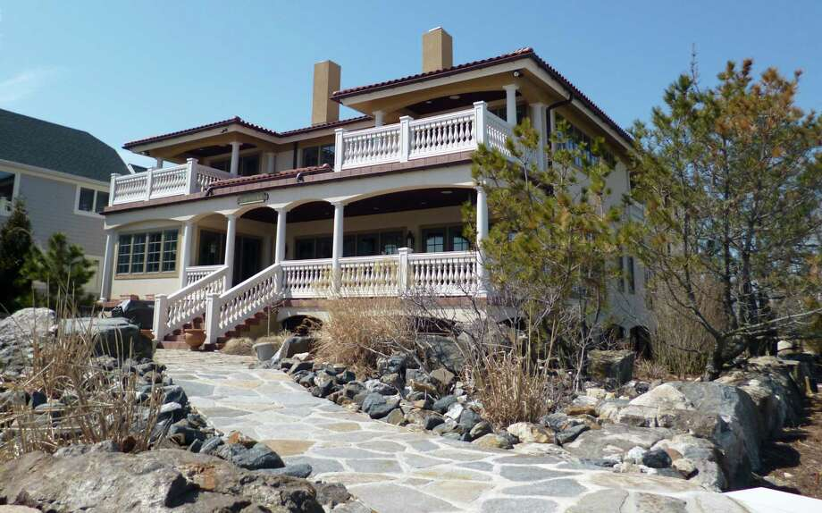 The waterfront house at 487 Fairfield Beach Road is on the market for $4,750,000. Photo: Contributed Photo / Fairfield Citizen
