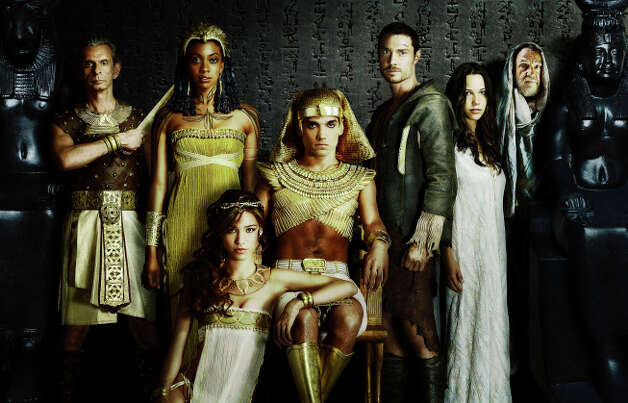 """HIEROGLYPH: The world of ancient Egypt - a time of magic, Pharaohs, gods and thieves - lives again in HIEROGLYPH, an exciting action-adventure series from creator/executive producer Travis Beacham (""""Pacific Rim,""""""""Clash of the Titans""""). The epic fantasy follows a notorious thief who is plucked from prison to serve the Pharoah, forcing him to navigate palace intrigue, seductive concubines, criminal underbellies and divine sorcerers, as he races to stop the downfall of one of history's greatest civilizations.  HIEROGLYPH will join the schedule in 2015 on FOX.  Pictured L-R: Antony Bunsee, Condola Rashad, Kelsey Chow (sitting) Reece Ritchie, Max Brown, Caroline Ford and John  Rhyse-Davies.  © 2014 Fox Broadcasting Co CR: Jacob Lewis/FOX. Photo: FOX / 1"""