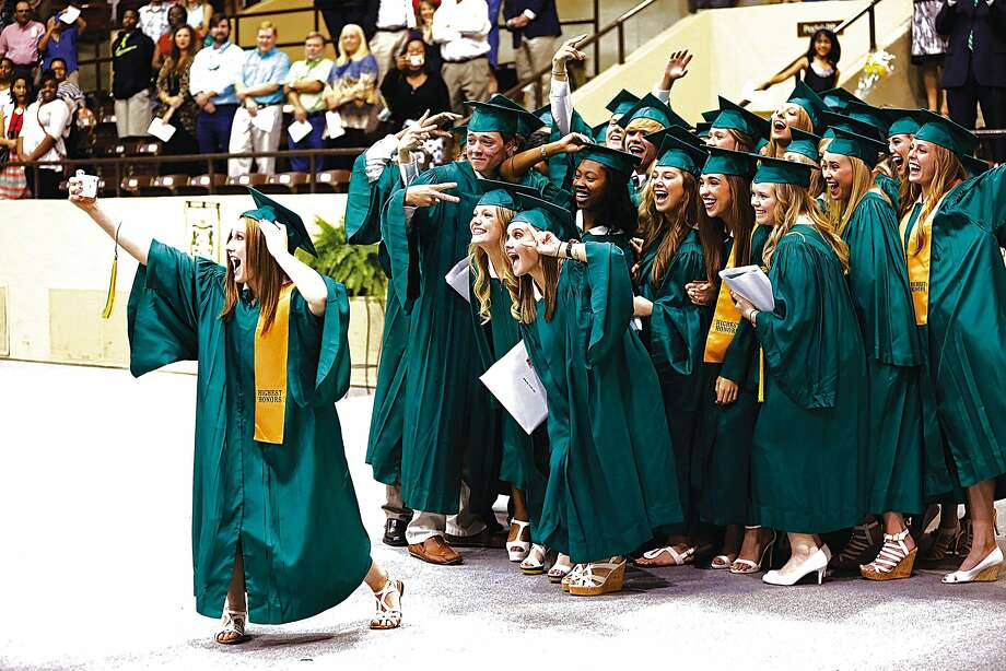 Group selfie: Kaitlyn Box snaps a cell-phone photo during Pillow Academy's commencement in Greenwood, Miss. 