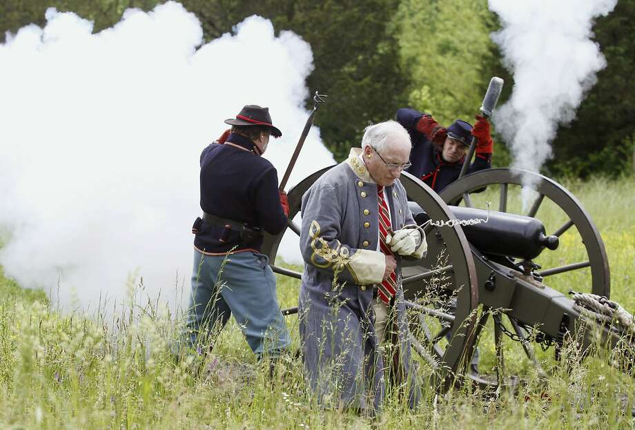 Barrel of fun:Former University of Georgia football coach Vince Dooley (center) fires 