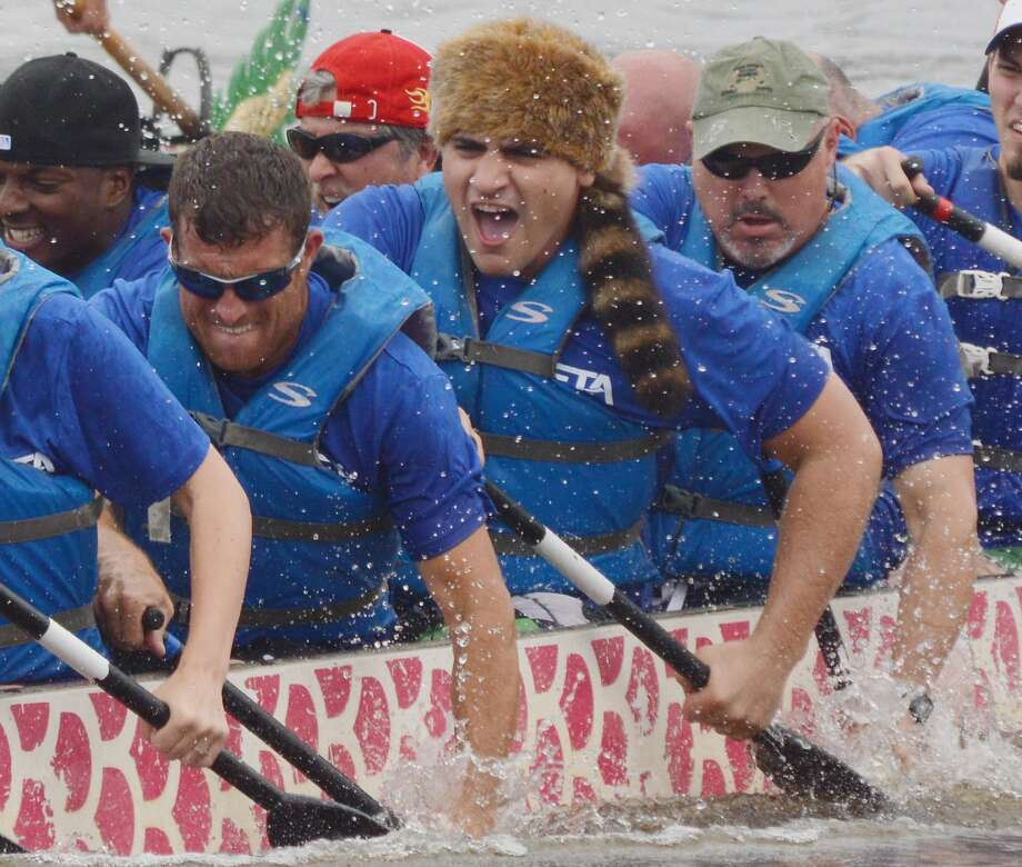 Remember the Alamo!The Beta Engineering dragon boat team paddles down the Red River   during the Louisiana Dragon Boat Races in Alexandria. Photo: Melinda Martinez, Associated Press