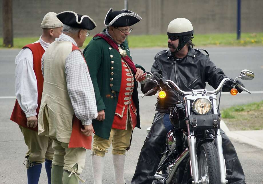Remember, Revere, one if by land, two if by sea: Members of Augusta Regiment greet 