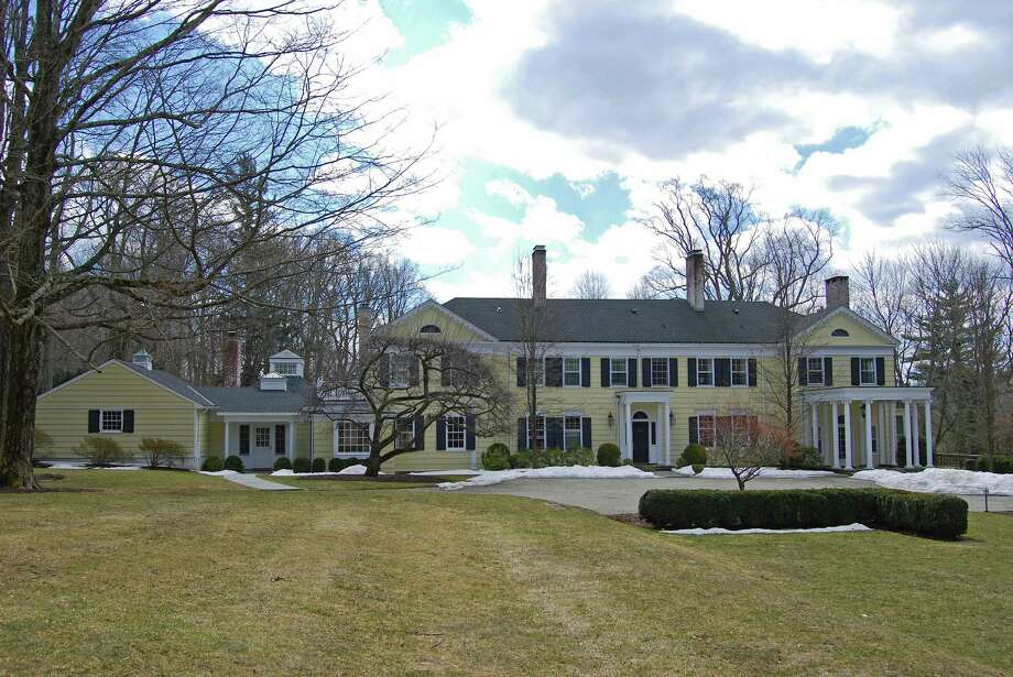 The Colonial at 281 Lambert Road in New Canaan, celebrating its 100th birthday, was designed and built by renowned architect Cameron Clark. It is on the market for $7,995,000. Photo: Contributed Photo, Contributed / New Canaan News Contributed
