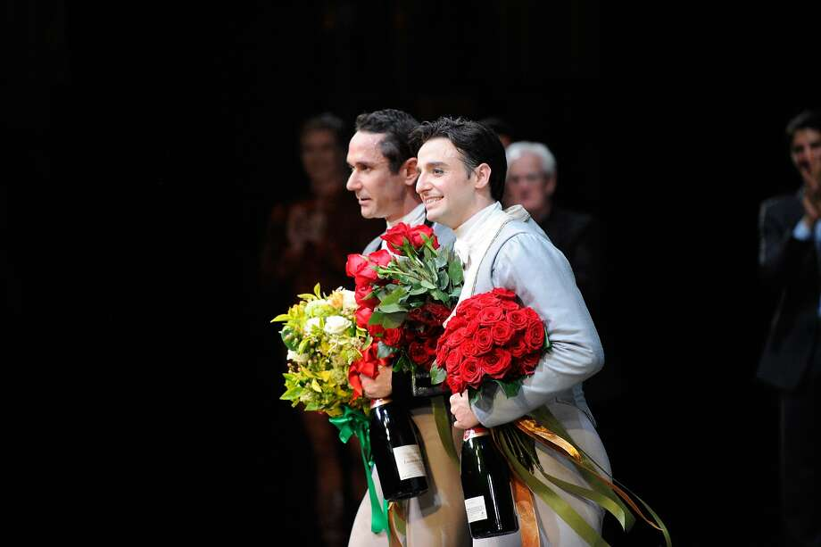 S.F. Ballet dancers Damian Smith (left) and Rubén Martín Cintas take a bow at the conclusion of their farewell tribute performance at the War Memorial Opera House. Photo: Erik Tomasson, San Francisco Ballet
