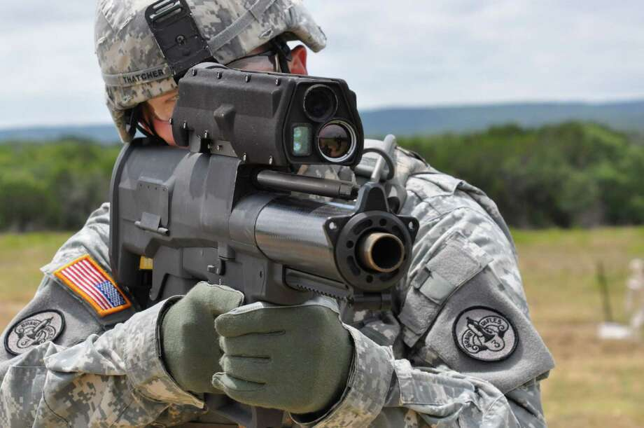 """Airburst/Counter Defilade Capability"" -- adapt current weapons to fire warheads that strike shielded targets. Here, for instance, a U.S. Army soldier fires the experimental XM25, whose airburst can detonate at a specific, pre-determined point near a hidden or obscured target. Photo: U.S. Army"