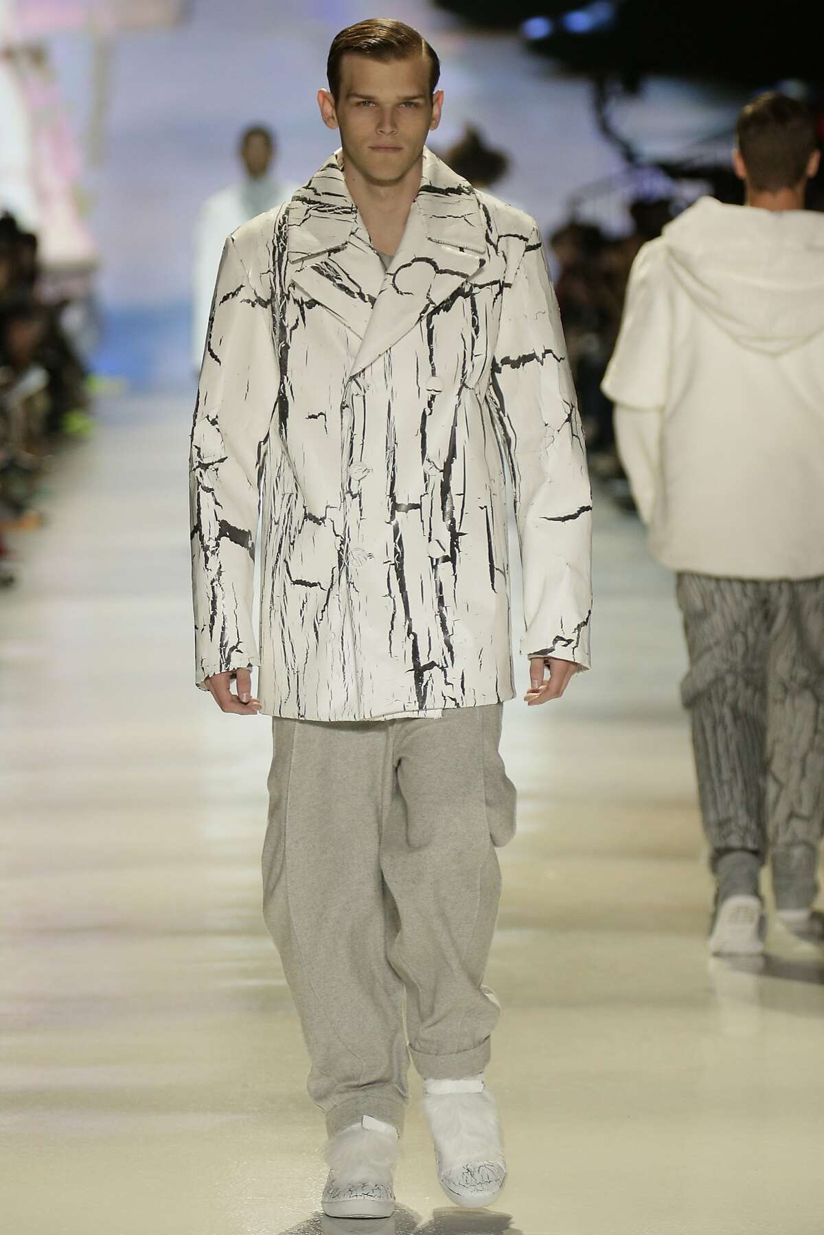 Student menswear designer Seth Olson created a novel fabric by coating denim with glue and then textile paint to create cracks that resemble fissures in blocks of ice, in a collection shown May 8, 2014 at the Academy of Art University graduation fashion show in San Francisco.