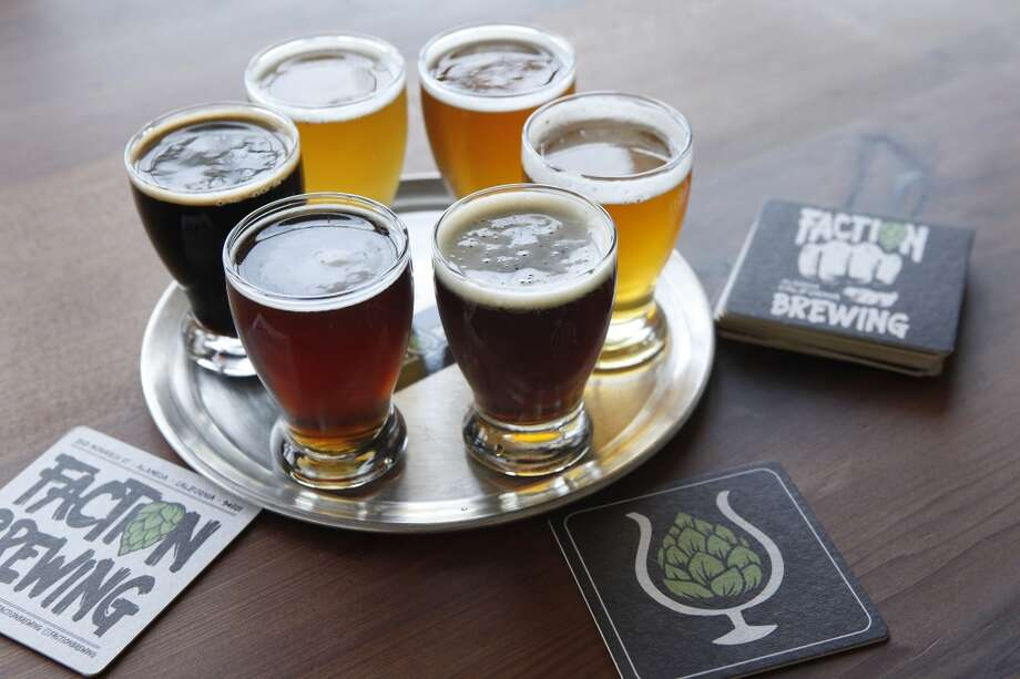 A flight of six beers, served on a pizza tray, is seen in the tasting room at the Faction Brewing Company in Alameda, CA, Wednesday May 7, 2014. Photo: Michael Short, The Chronicle