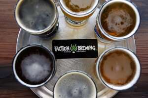 A flight of six beers, served on a pizza tray, is seen in the tasting room at the Faction Brewing Company in Alameda, CA, Wednesday May 7, 2014.