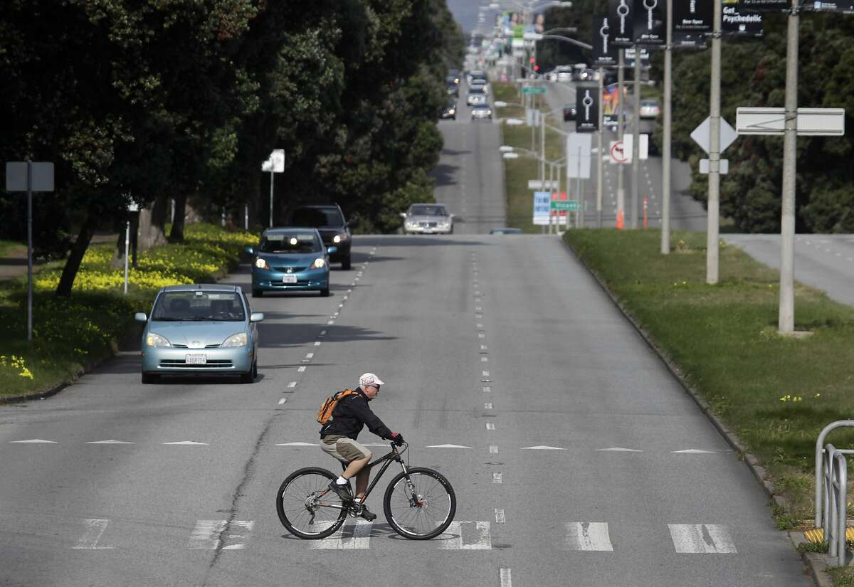 A bicyclist rides across Sunset Boulevard at Yorba Street in San Francisco, Calif. on Wednesday, Feb. 5, 2014. A pedestrian was hit and killed at the same intersection by a car traveling southbound on Sunset.