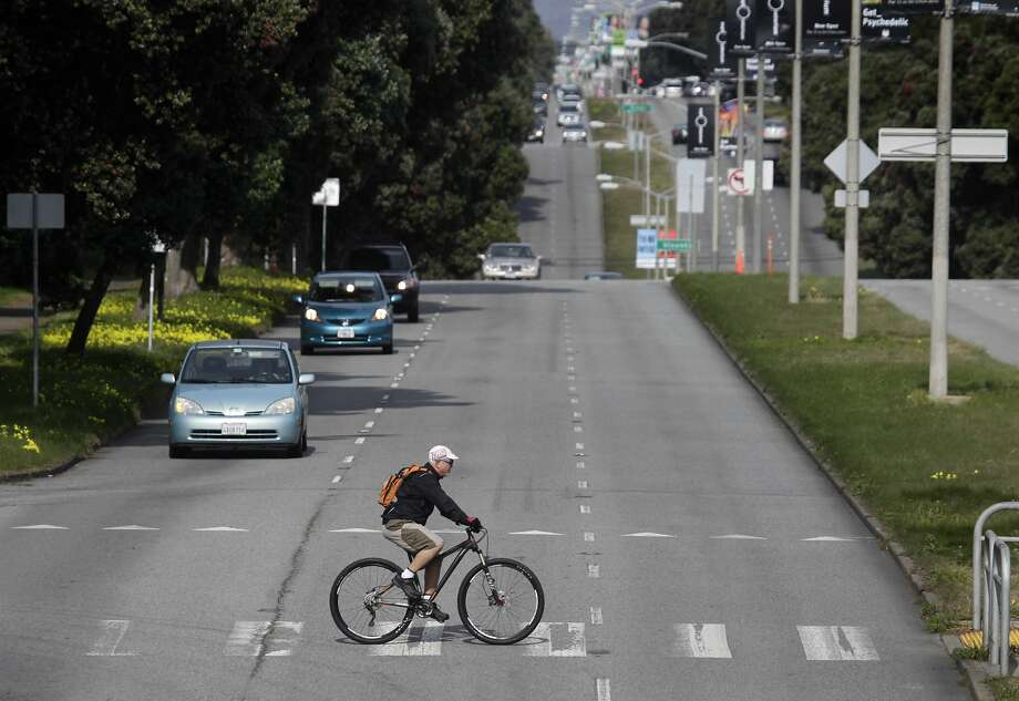 A bicyclist rides across Sunset Boulevard at Yorba Street in San Francisco, Calif. on Wednesday, Feb. 5, 2014. A pedestrian was hit and killed at the same intersectionTuesday by a car traveling southbound on Sunset. Photo: Paul Chinn, The Chronicle