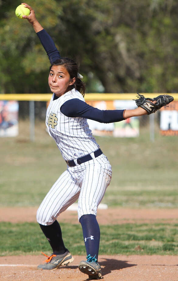 Julia Ibarra of Holy Cross winds up for a throw to the plate during the first inning of their game at TMI on March 20. The Knight beat the Panthers that day, but lost to the Flyers last week in the state quarter- finals. Photo: MARVIN PFEIFFER, EN Communities / Express-News 2014