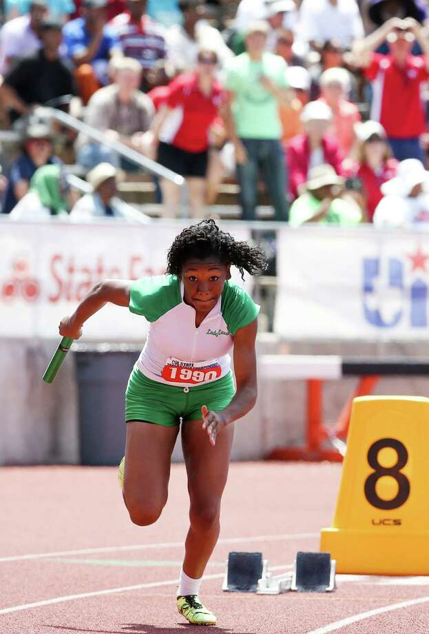 Sam Houston's Jasmine Darden gets off to a fast start as she leaves the blocks in the 3A 400-meter relay during the UIL state track meet at Mike Myers Stadium in Austin on Saturday. Sam Houston finished third in the event with a time of 3 minutes, 47.96 seconds. Photo: Marvin Pfeiffer / Southside Reporter / Express-News 2014