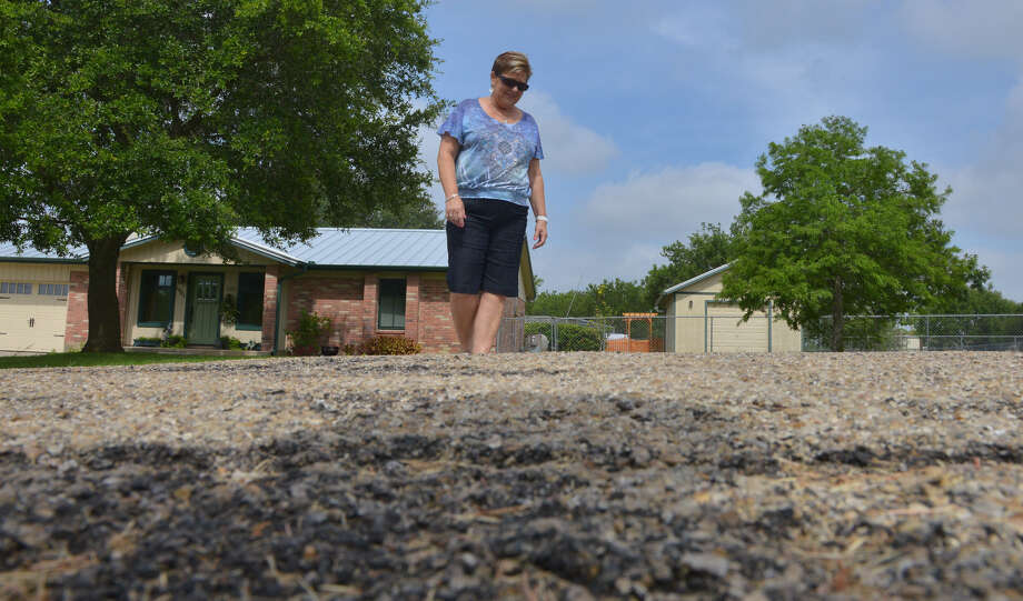 Alice Pollok surveys a damaged road in China Grove's Tierra Bonita in 2013. Pollok was elected Saturday to the City Council. Photo: Robin Jerstad