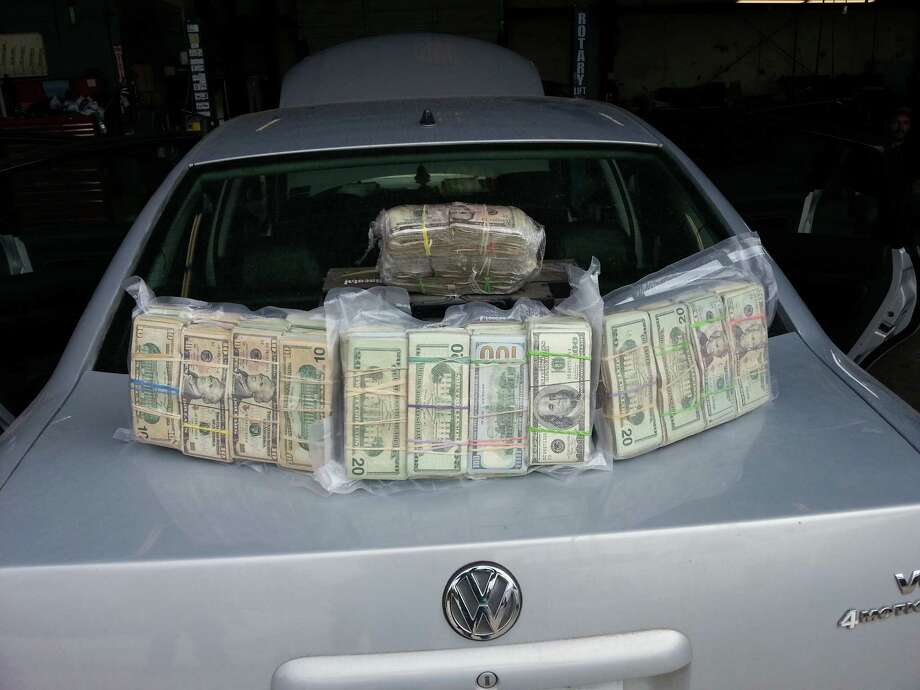 Fort Bend County Narcotics Task Force members found $125,610 hidden inside the two front seats of this car, May 7, 2014. Photo: Fort Bend County