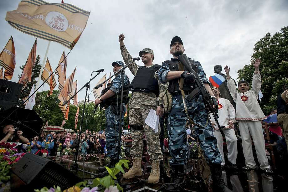 Pro-Russian gunmen and activists celebrate as they declare independence for the Luhansk region. The Donetsk area is also seeking self-rule. Photo: Evgeniy Maloletka, Associated Press